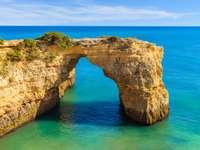 Rock cliff arch near Marinha beach in Portugal