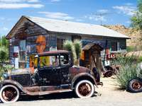 American vintage car at old gas station